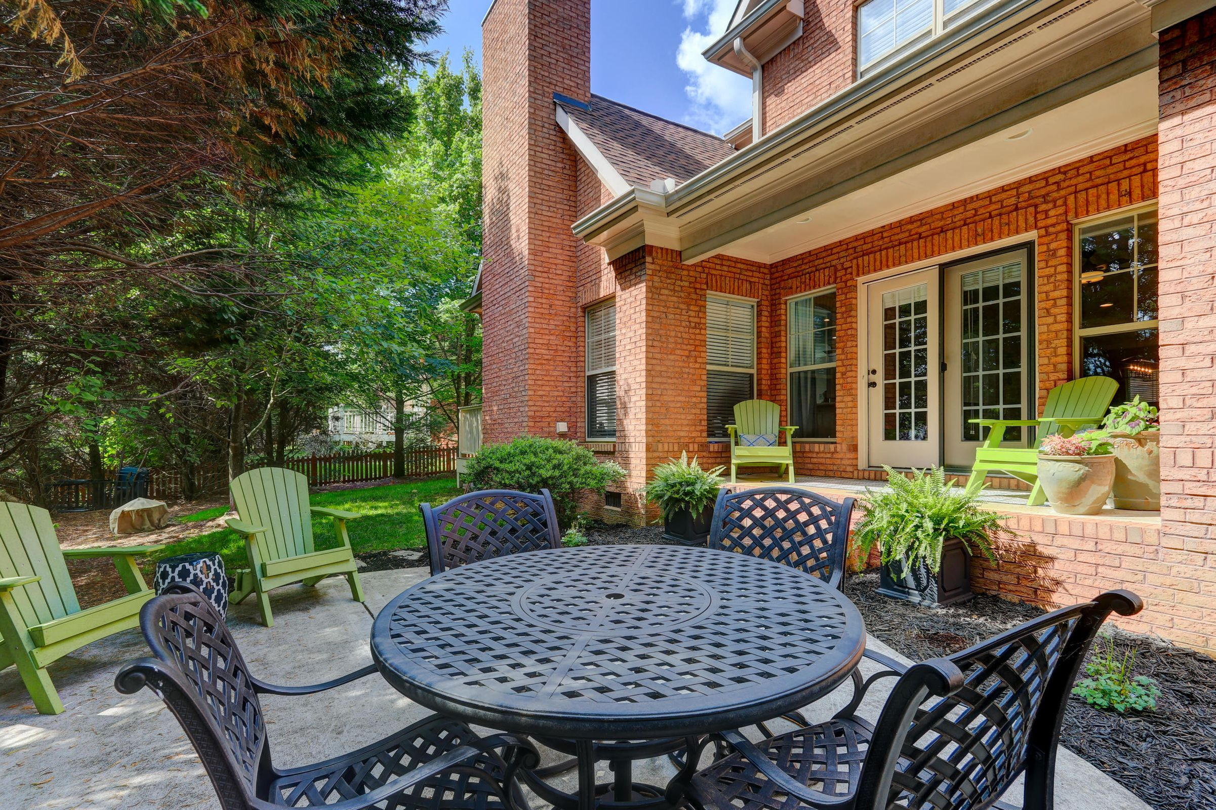 Back patio with tree-lined privacy