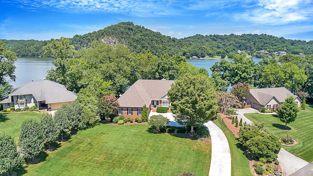 Aerial of Home w/ Lake Views