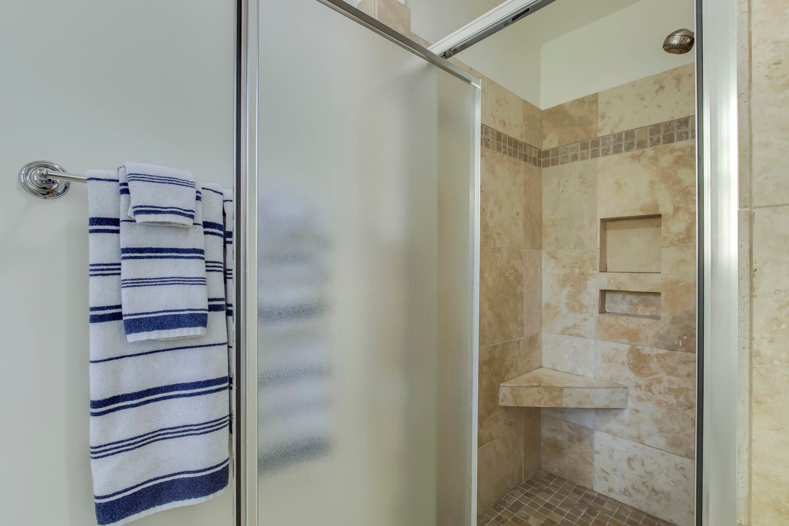 Travertine Walk-in Shower in Master Bath
