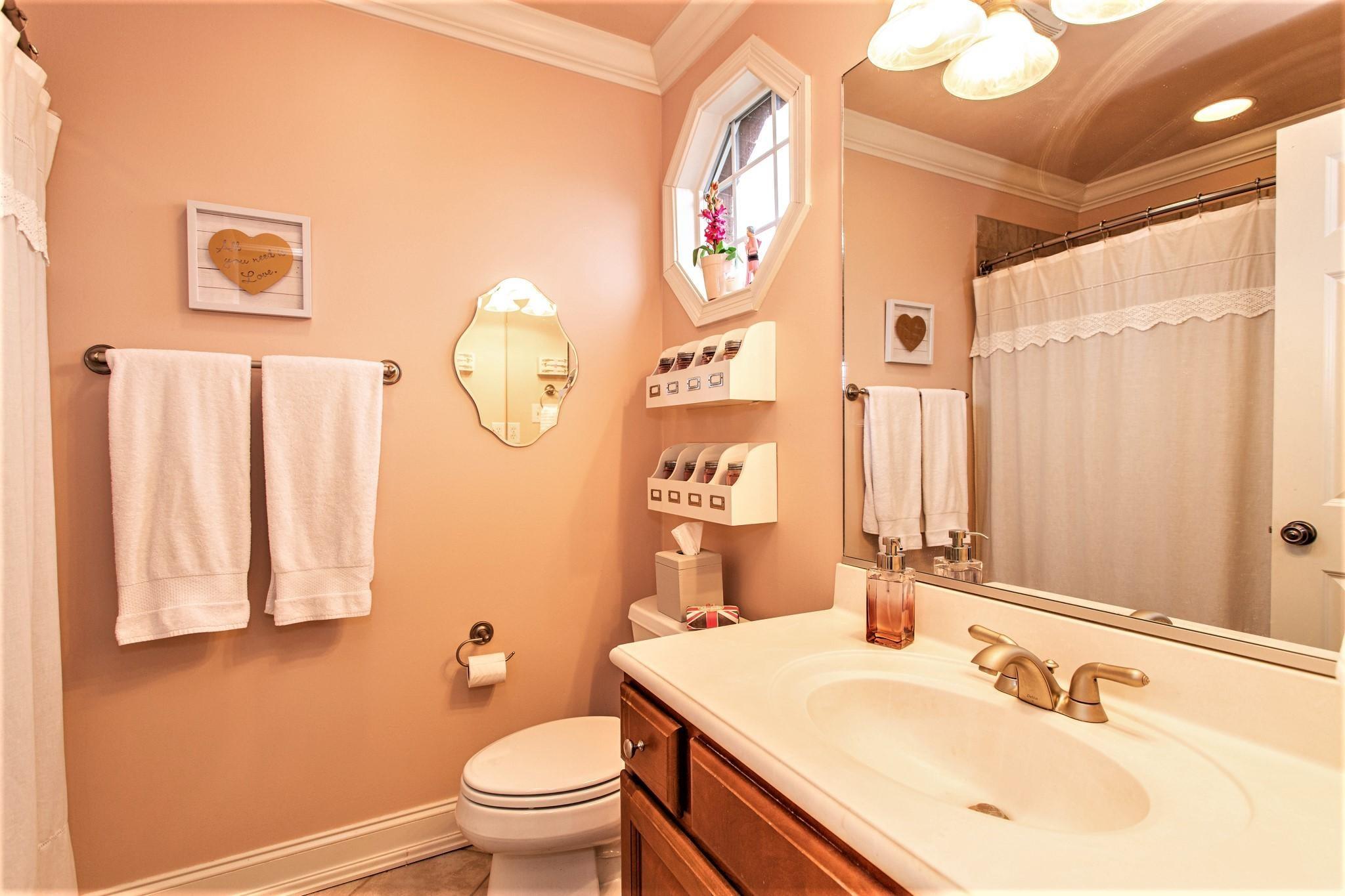BATHROOM WITH ADJOINING BEDROOM
