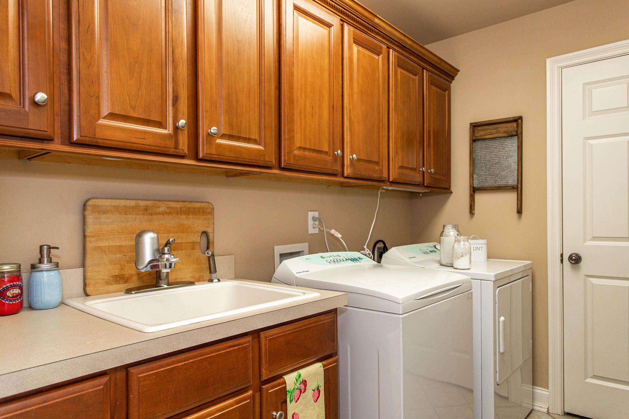 LAUNDRY ROOM WITH CABINETS AND STORAGE