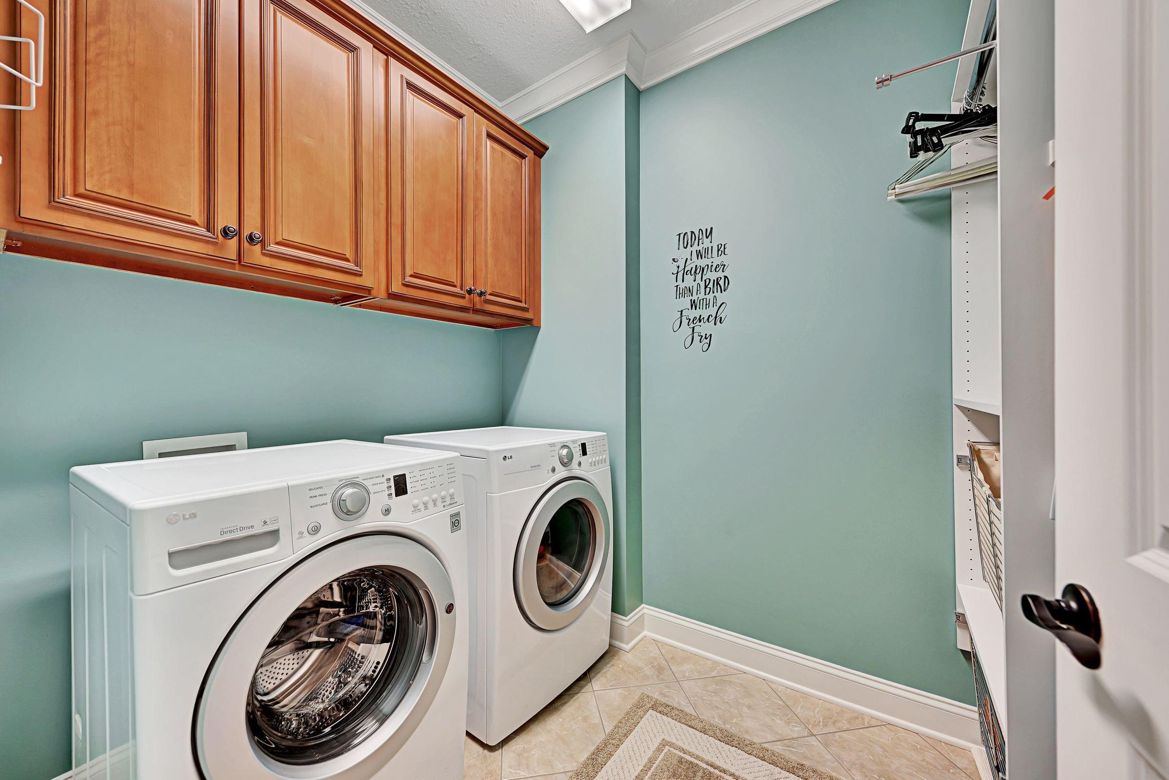Laundry room with cabinets, shelves