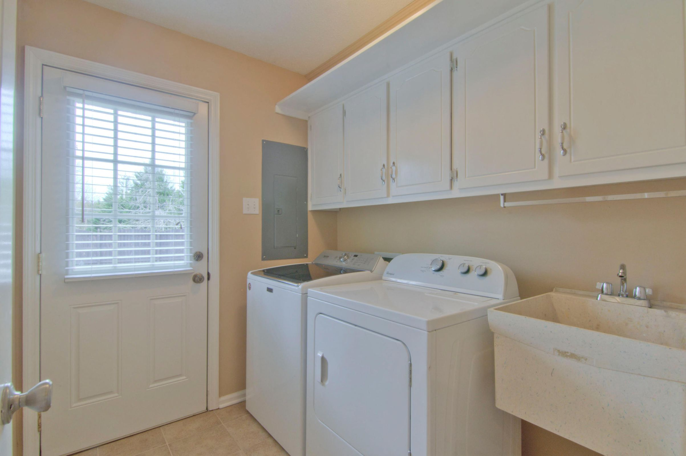 LAUNDRY RM HAS CABINETS & OUTSIDE ENTRY