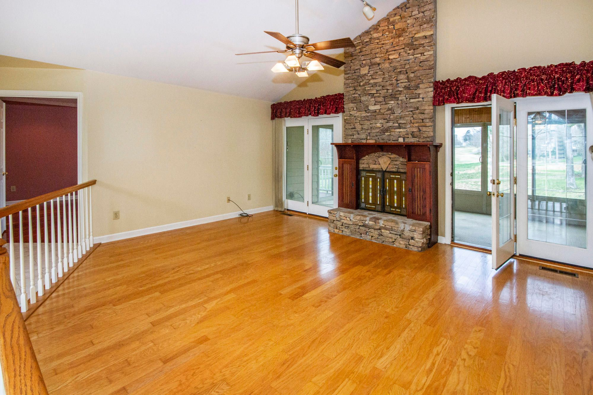 Golf View Living Opens to Sunroom...