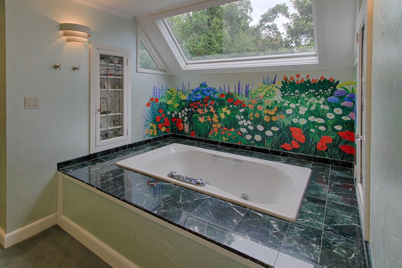 Master tub, mural and skylight