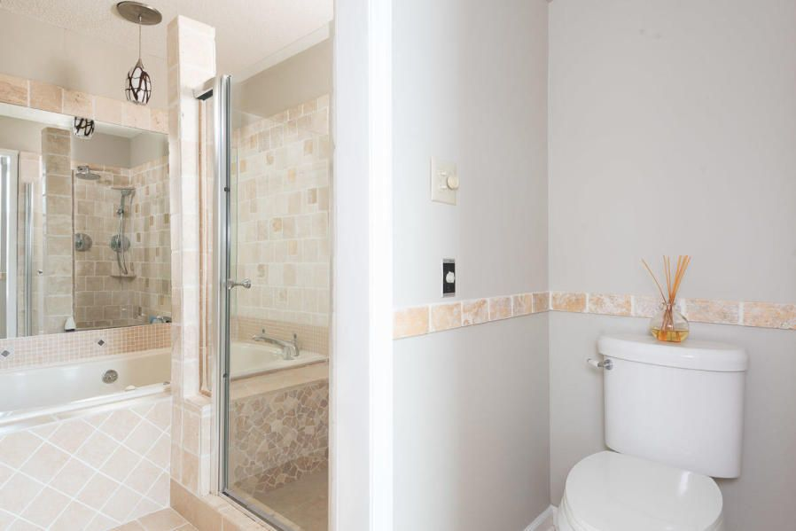 Master walk in tile shower/whirlpool tub