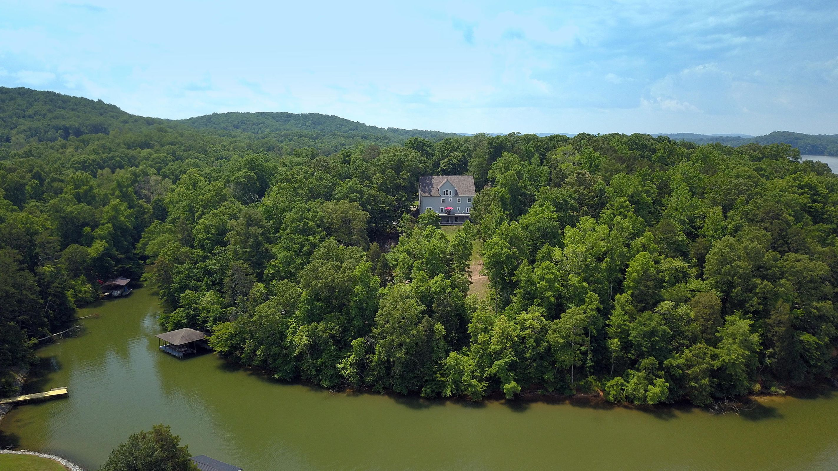 Over 12 acres and 1000 ft. waterfront