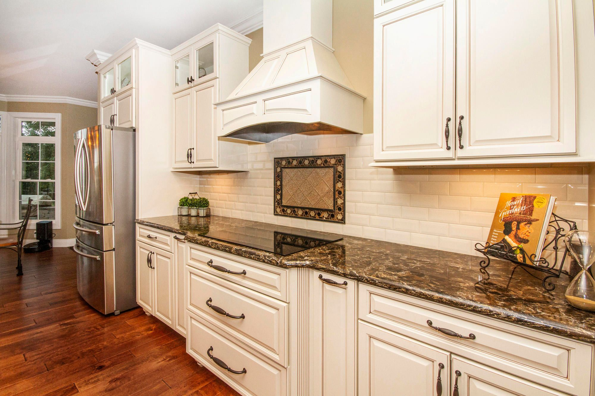 Pretty Mosaic Inset & Ivory Cabinetry!