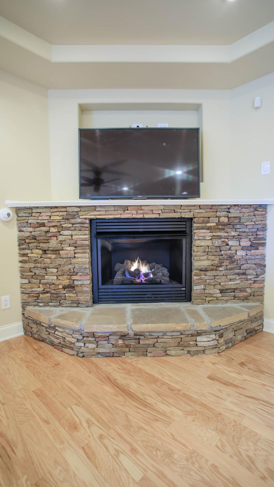 Gas electric start fireplace