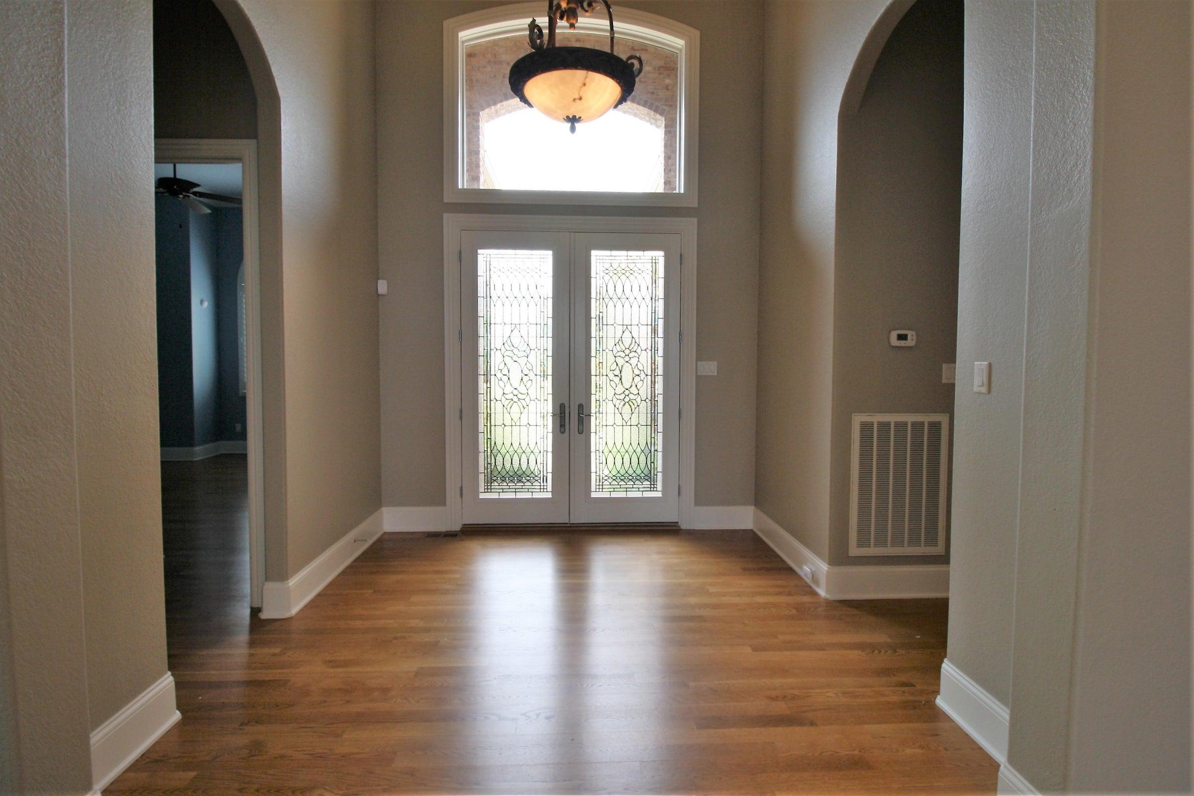 Double front doors lead to great room