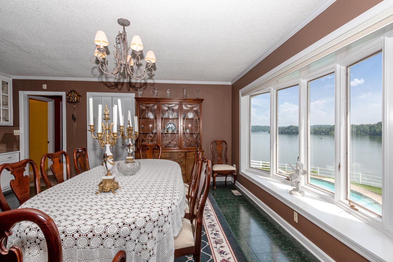 Dining area bay window with lake view