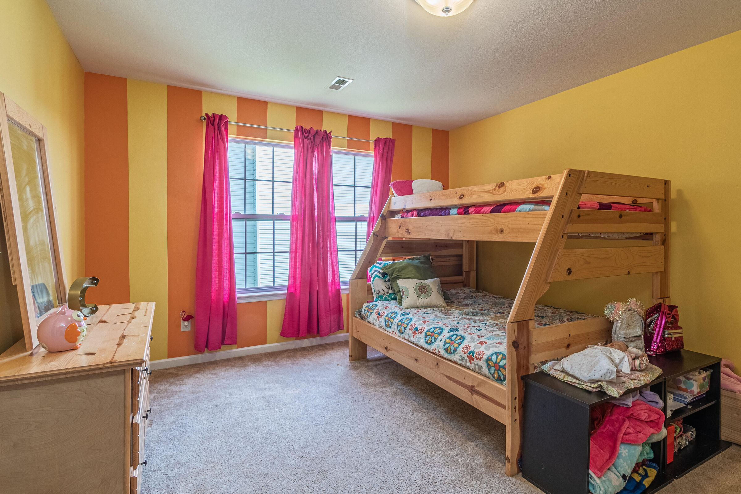 Bedroom with walk-in closet