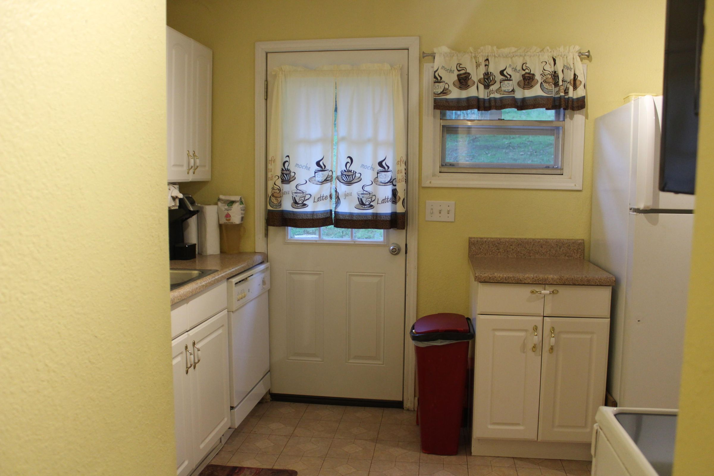 Door to outside in kitchen