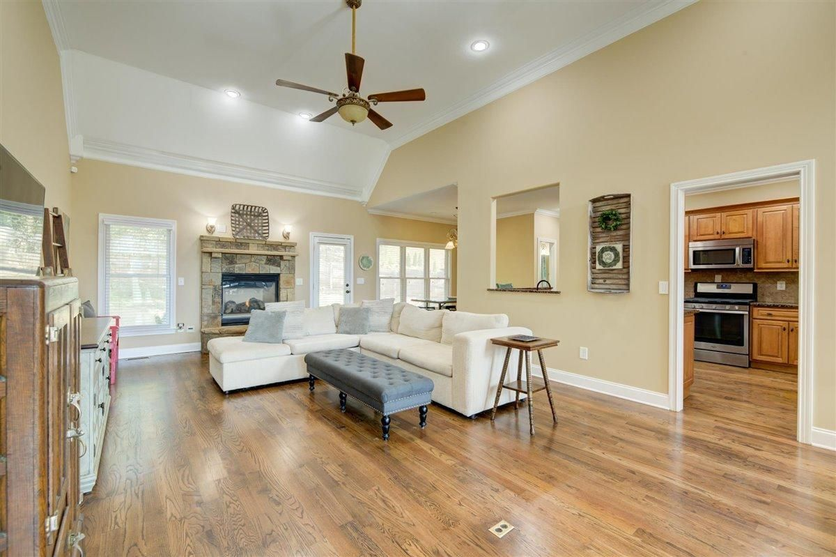Fireplace, hardwood & soaring ceilings