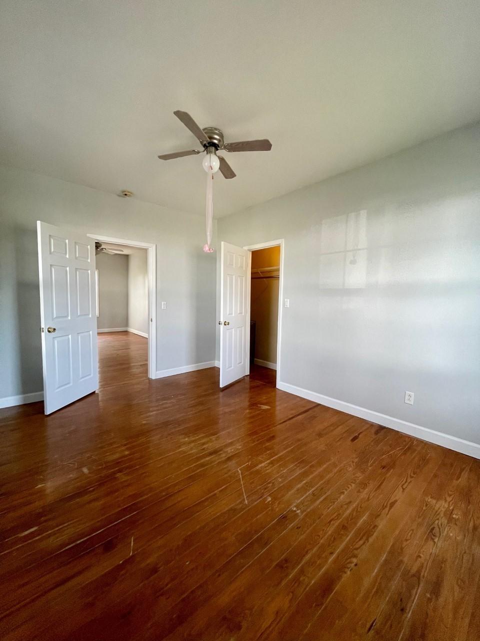 Bedroom 1 with hardwood floors