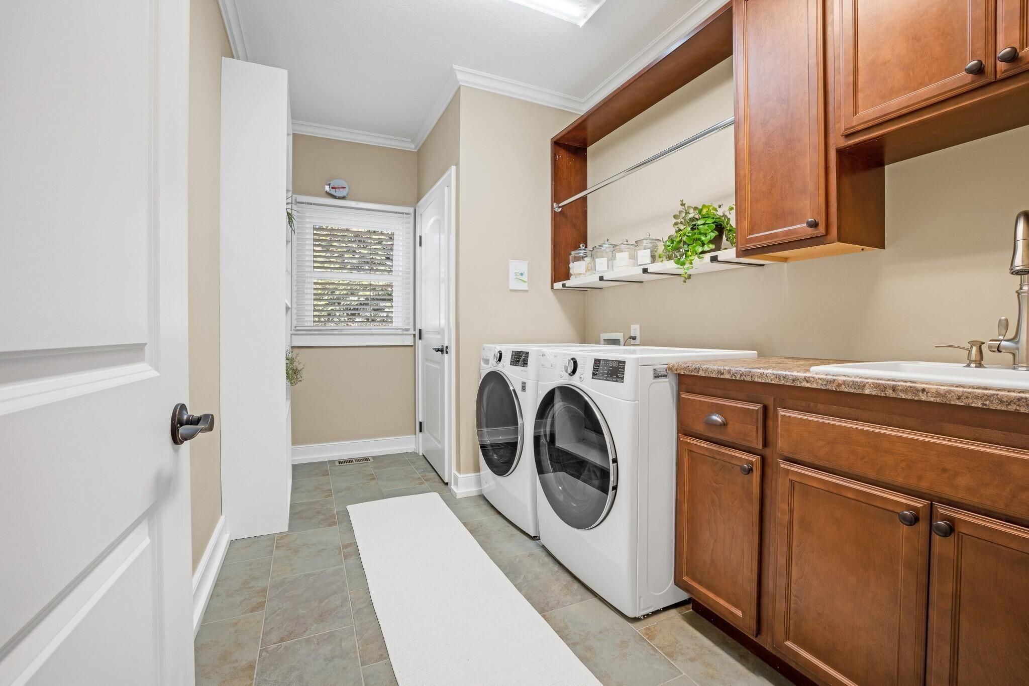 Laundry Room w/ Cabinets and Sink