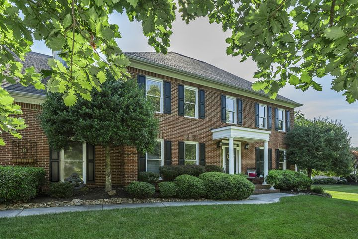 Brick Traditional Home located on large .49 Acre Manicured Site in Heart of Farragut- Subtle colored mortar highlights the soft brick color.