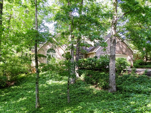 Rare single level home on private wooded lot!