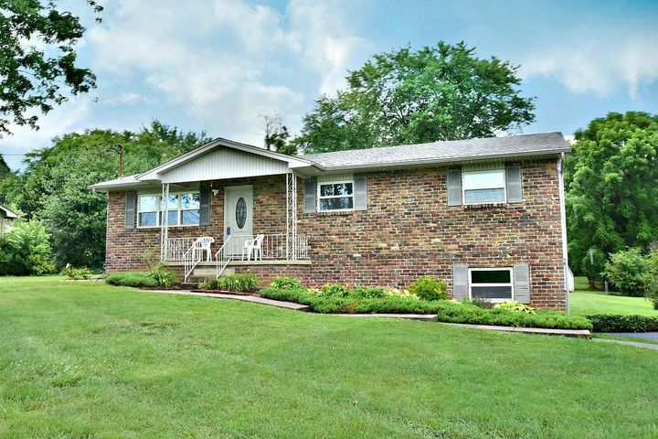 APPEALING BRICK/VINYL BASEMENT RANCH HOME