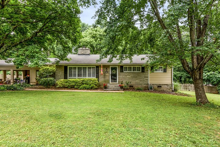 Lovely Westwood Rancher with beautiful flat yard. 3 bed and 2 updated baths. Covered back patio and wonderful street. Close to everything.