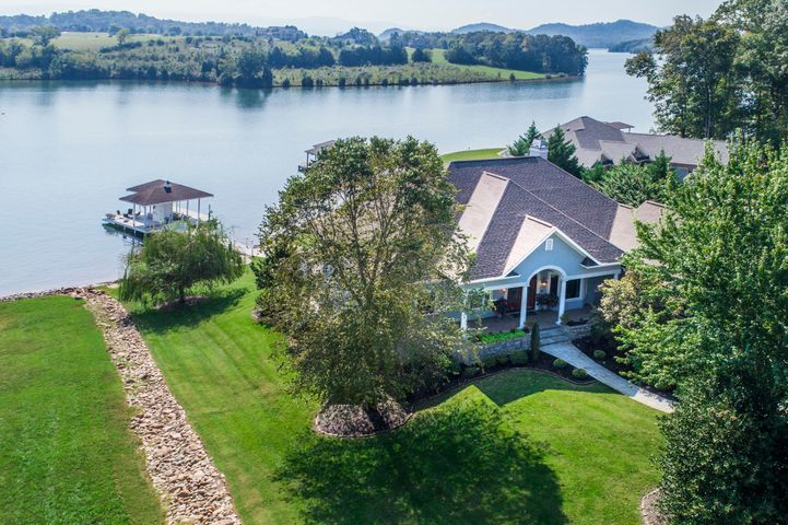 Wonderful Lake Front Home with Dock, Level Lot, 3-Car Garage & Elevator!