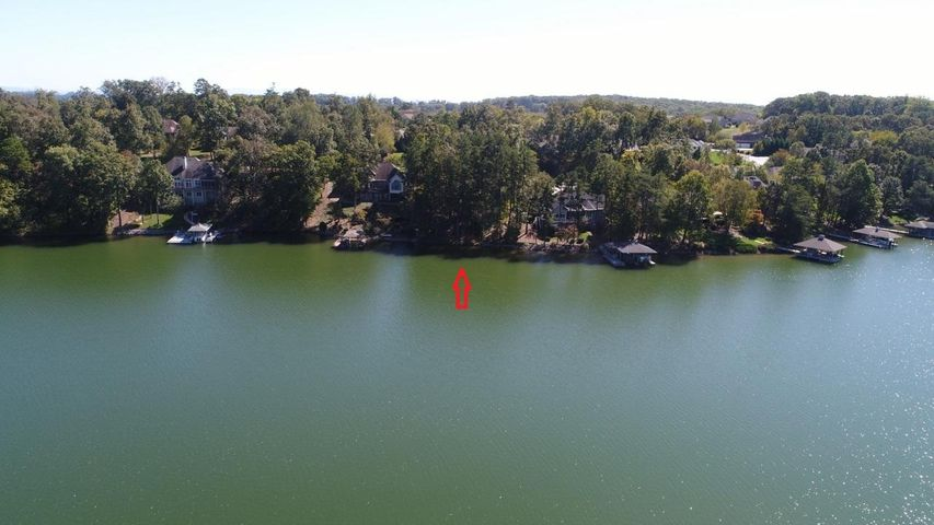 Come visit this awesome on lakefront lot on Miami Lane in Tellico Village.