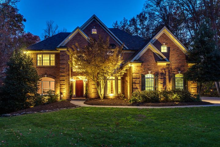 """This impressive and inviting home has so much to offer, inside and out! Professionally designed and installed landscape and outdoor lighting set off the beauty of the architecture perfectly, and provide a warm """"welcome home"""" to dwellers and visitors alike."""