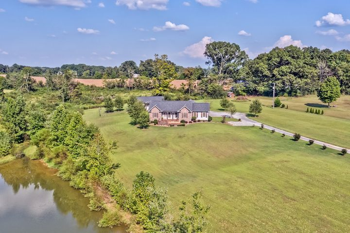 Rancher w/Over 30 Acres, Stocked Pond & Workshop/Kennel