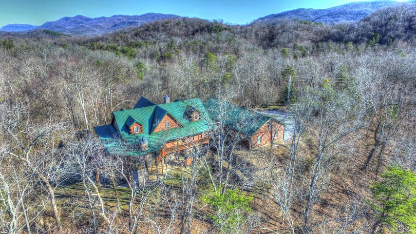 12 ½ private acres, Smoky Mountain backdrop, gated community, close to town.