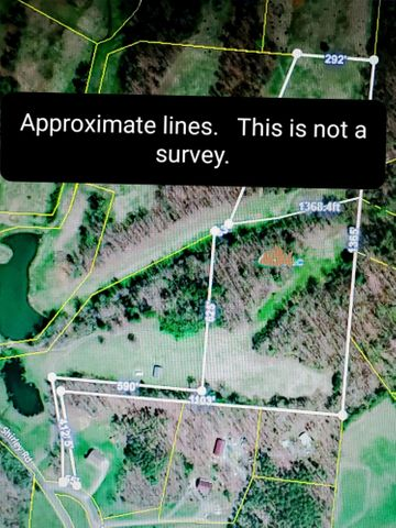 Overlay of tax map as a reference. This is NOT a survey but for reference of approximate property lines.