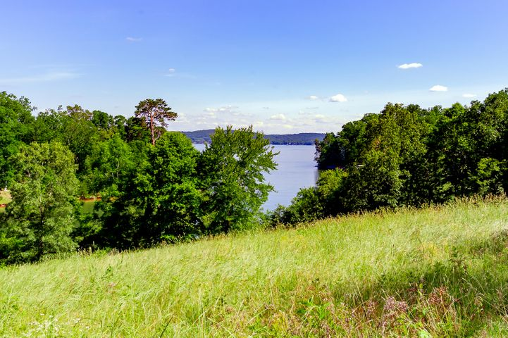 Large two parcel property with expansive lakefront and beautiful views.