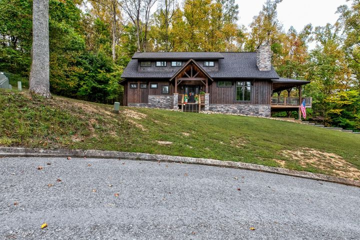 Welcome home to this custom home just a golf cart ride away from Twin Cove Marina