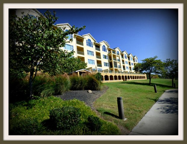 Lake front living with no maintenance. Very tastefully decorated condo at Harbor Crest. Many updates. HOA fees includes sewer, propane for fireplace,  fitness center, jacuzzi, and pool. Purchase price includes (1) bsmt. parking spaces & hall storage space.