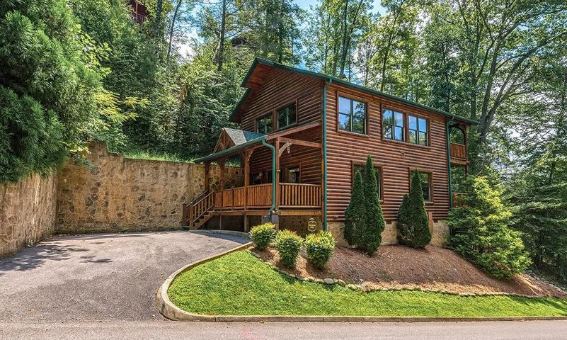 2 bed 2 bath log style home located in prestigious Gatlinburg Falls Resort! This unit has a pool table, air hockey, arcade game, hot tub, sleeps 10, and is projected to do $47,000 to $50,000 per year. Call me and find out how to improve these numbers and maximize your rental potential. Don't miss the video tour