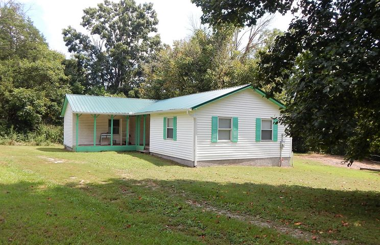 This cute ranch style L shaped home is on a dead end street and 1.4 flat wooded acres! Walls have been removed to obtain a great open floor plan, Kitchen updated, and new flooring has been installed throughout. The floor plan is a very desirable split bedroom, with the master on one end and two additional bedrooms on the other. Metal roof is in fantastic shape, and the water heater is only two years old. Attic access is located in hallway bath closet.This home is just waiting for you and your finishing touches! Should qualify for 100% USDA financing as well as THDA 15K down payment assistance... Seller is motivated, bring offers!