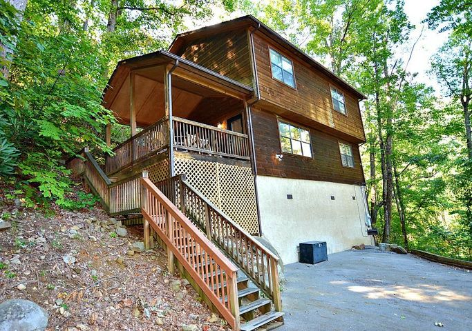Spacious 3 bedroom 2 bath, nearly 2,100 square foot cabin. Just minutes to downtown Gatlinburg! The main level offers a master bedroom, game room, and a covered deck with a hot tub. The second level includes a large great room with fireplace, an open dining area, and a full kitchen! There are two bedrooms and a second bath on this level. Beautifully appointed with lots of space - come see it today!** Projected rental income $45,000-50,000.