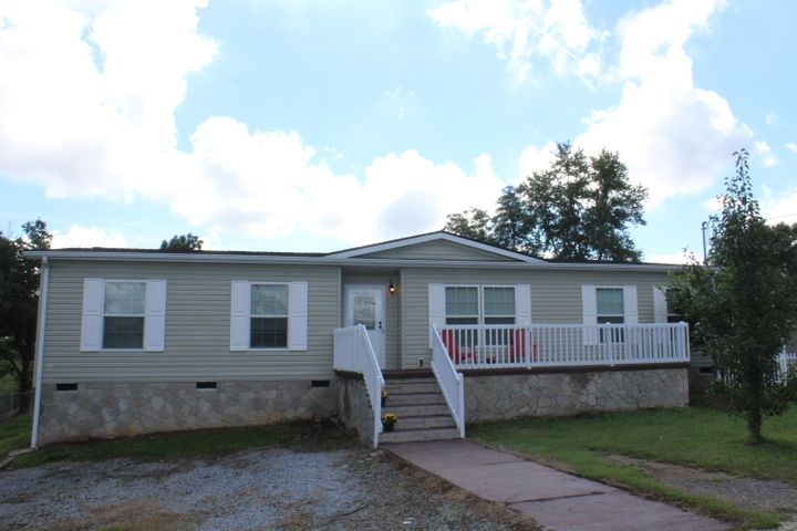 This newly renovated cozy 4 bedroom, 2 bath home features new flooring through out.  There are two large decks for enjoyment and gathering.  Spacious closets, formal dining area, and laundry room.  This property is an absolute must see!!