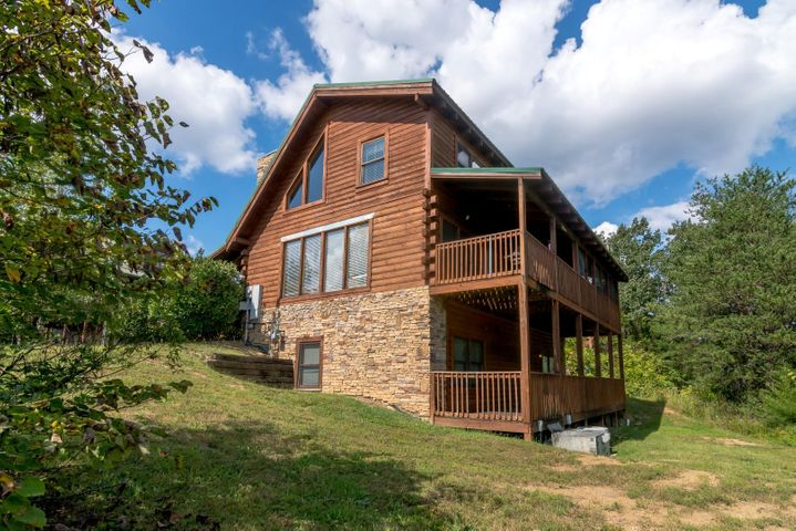 6 bedroom, 5 bath cabin in Eagle Ridge North with a nice view! Excellent location close to the Parkway in Pigeon Forge. Convenient to most all area attractions. Features include an open floor plan, cathedral ceilings, hardwood floors, gas log fireplace, and a large master suite. Comes fully furnished and decorated. Does great on rental. Offeredat an excellent price!