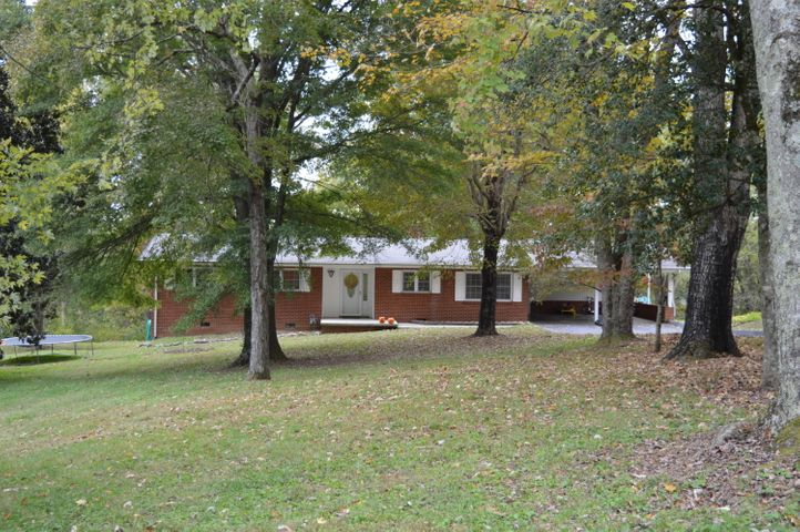 Wow, over an acre, this all brick, 3 BR/2 BA rancher. LOCATION - LOCATION! 12 minutes to W. Knox, 10 minutes to O. Ridge, & 12 minutes to Powell. Seasonal river view, walk in crawl space is big enough for a workshop & a very large level yard.Living room is very spacious & has a gas fireplace with a view of the river in the fall/winter. Enclosed sun-room for extra living area. Large eat in kitchen with plenty of cabinets. Spacious back yard will host many cook-outs. Front yard is expansive & beautiful. Boat Ramp is less than two miles away along with Haw Ridge Park. If the trees were cleared off, year round views of the river would be amazing.  Seller is offering a 1 year home warranty with Choice Home Warranty.Won't last long at this price, schedule your showing asap.