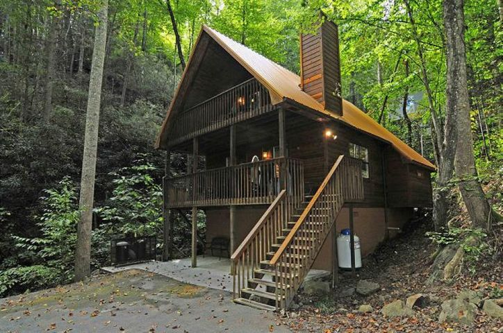 Nestled beside a mountain stream, this cozy 2 bedroom, 2 bath chalet is only about a mile from the first traffic light in Gatlinburg. Nicely updated with oak flooring, handsome furnishings and tasteful fixtures. Versatile outdoor space includes two covered decks to enjoy Smoky Mountain rainfalls while watching the creek flow.  There is an open deck with a hot tub overlooking the stream. Two levels with vaulted ceilings, open loft and a mountain stone gas fireplace.  This chalet is used as a two bedroom, each with a separate bath.  There is a bedroom/bathroom suite on each floor + an open loft. This chalet produced $23k in 2017, and $33K in 2018! The roof is only 4 years old! Hot tub was replaced in 2016!
