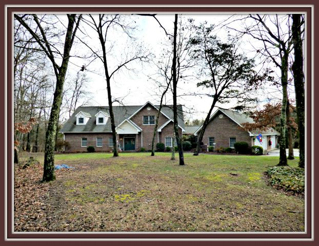 Well designed custom brick home w/ adjoining acreage available. Master suite on main level as well as 2nd BR. Open floor-plan, curved fireplace & so much cabinet space in the kitchen. Upper level has bonus room & 3rd BR & bath. Lower level has large den with bar, office, & more sleeping quarters. Great location near Douglas Lake!