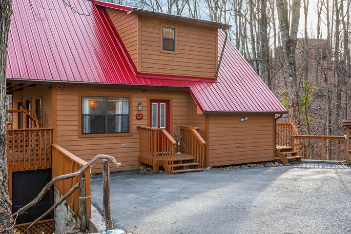 Lovely Mountain Chalet, 2BD/3BA only minutes from downtown Gatlinburg and  Arts & Crafts Community. Great rental income potential (see supplement document on rental income projection). 2nd home or vacation property with relaxing wooded views from the 3 covered deck levels. Lower level was remodeled with full kitchen, bathroom and outside entrance-perfect for an Airbnb.No HOA fees!Comes furnished.