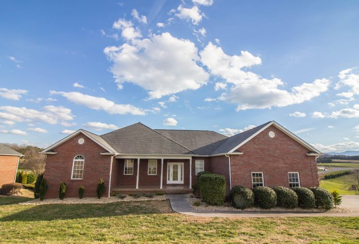 This beautiful four bedroom, all-brick home is situated in the most desirable subdivision in Sevierville - LeConte Landing. Located just minutes from the Hospital, Shopping, easy access to main and back roads, schools and area Attractions. There is about 4126 square feet of finished living space between the main level and finished basement - plenty of room for the whole family and guests. Split floor plan with Master's Suit and 3 other bedrooms on the main floor, finished basement features huge living room with wet bar, full bathroom and 3 additional rooms! There are many extras and features such as wood floors, cathedral ceiling in living room, 3 car garage! spacious laundry room, walking closets, office and two large decks with the beautiful views of the Smoky Mountains