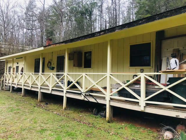 If you are looking for an investment property that needs rehab in the heart of Gatlinburg, this is the property for you! This is a 3 bedroom/3 bath home among the trees of  the Smoky Mountains. This property has additional living space with a kitchen and full bathroom. This would make a terrific rental property in the highly desired community of Gatlinburg. Being sold AS IS. As with all Real Estate transactions buyers should verify all information independently including HOA info. Buy title insurance, have a survey, home inspection and all other inspections. Buy home insurance. Equal housing opportunity. Square footage taken from tax records and a rough measurement of home. Buyers should verify all square footage of each room. Square footage not guaranteed/Room sizes not guaranteed