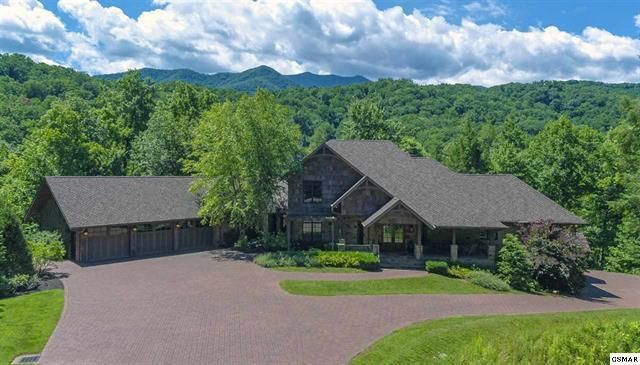 Spectacular, private, gated estate in the heart of Gatlinburg on over 3.8 acres offering an escape to a time and place where all the world issues are faded away.  Grand and cozy - just as a mountain lodge should be, find an intuitive layout with thoughtful design finishes and beautiful custom features throughout. Convene for a game of cards or simply sit and swap stories around the roaring stack stone fireplace, in the impressive great room.  This private estate is within minutes of Gatlinburg shopping and restaurants. Delight in the serenity of the mountains, while exploring the many miles of well-maintained mountain trails of the nearby Great Smoky Mountains National Park. The home boasts luxury finishes throughout the 3 stories -