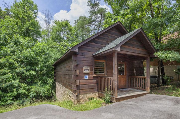 Cozy and Romantic studio cabin just minutes from Pigeon Forge.  Don't let ''studio'' fool you, this is a very spacious cabin with galley kitchen, and full size appliances.  Great counter space as well.  Inviting heart shaped whirlpool tub, wood floors, and electric fireplace.  The porch features a hot tub and a swing for two to just sit and enjoy the sounds of nature.  On rental program with good numbers.   Just a short drive to Gatlinburg, Sevierville and of course The Great Smoky Mountain National Park.