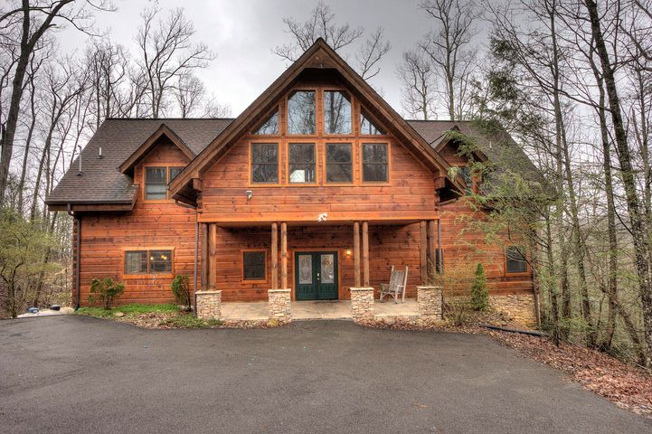 GROSS RENTAL INCOME OF $90,039 IN 2018. Gorgeous cabin is currently rented as a 5 Bedroom 5.5 bath mountain retreat in a PRIVATE WOODED SETTING ON 3.57 ACRES. MAIN FLOOR FEATURES grand entrance into a spacious & OPEN LIVING ROOM with DRAMATIC VAULTED CEILINGS, WOOD FLOORS, Large MASTER SUITE with a walk in closet. KITCHEN offers GRANITE COUNTERS and is equipped to handle large gatherings. UPSTAIRS you will find 4 more MASTER SUITES with their own private bathrooms and GRAND GAME ROOM with cathedral ceilings, POOL TABLE, ARCADE GAME. Cabin has 4 bedroom septic permit. Cabin is located 20min from DOWNTOWN GATLINBURG. Ample amount of back road options to Pigeon Forge & Sevierville.