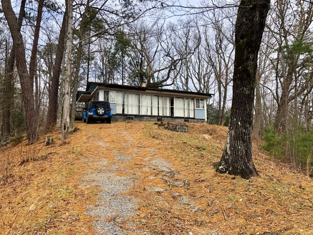 Location is everything !! A highly desireable rental community area. Don't miss out on this opportunity to own in Gatlinburg. 1120 SF home nestled on 8.74  wooded acres, located minutes to 321, downtown Gatlinburg ,attractions and the Great Smoky Mountains National Park. This property has so much potential.