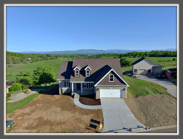 This is the one you've been looking for! New construction with amazing mountain and lake views. Easy flowing open floor plan. 10X16' deck and 10x16' concrete patio, 1800 SF unfinished walkout basement is ready for your design and orientation for all of your desired uses. 9' Ceilings throughout and crown molding in most rooms. Main floor all hardwood with porcelain tile laundry, guest bath and master bath which has large walk-in porcelain shower. Kitchen has granite counters & large island, both baths have granite counter tops. Finished 12x24' bonus room over garage. Check with Listing agent for updates.