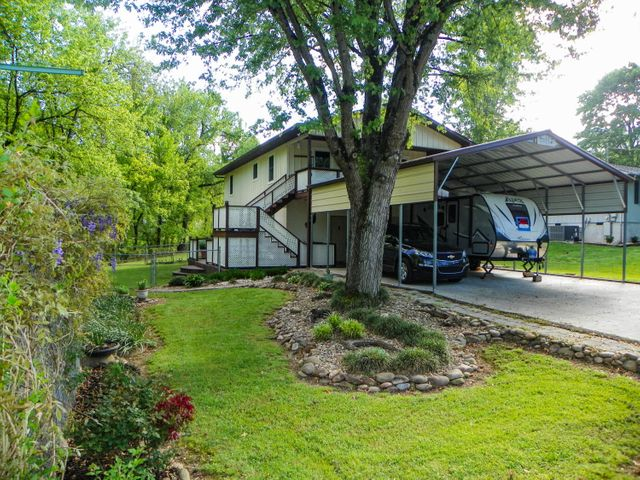 Wonderful Location! Just off the Parkway in Pigeon Forge and minutes from shopping, restaurants and entertainment this home could be used as a second home or permanent residence. Offering a metal roofed carport tall enough to fit your R/V, newly renovated kitchen, and beautiful, maintenance free vinyl laminate flooring throughout the 2nd level. The finished basement on the 1st level could be used for a home business or mother-in law apartment. Relax on the upper deck as you listen to the sounds of the creek and enjoy this quiet, peaceful neighborhood. (NOTE: This home is in Flood Zone AE. See Associated Docs for FEMA Flood Map.)